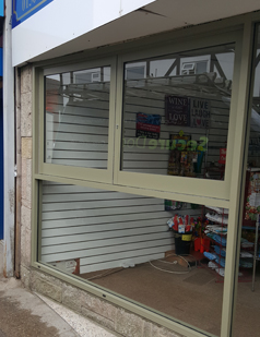 Shop front shutters fitted by SDG UK