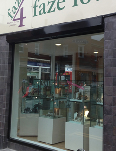 Shop front shutters supplied by SDG UK